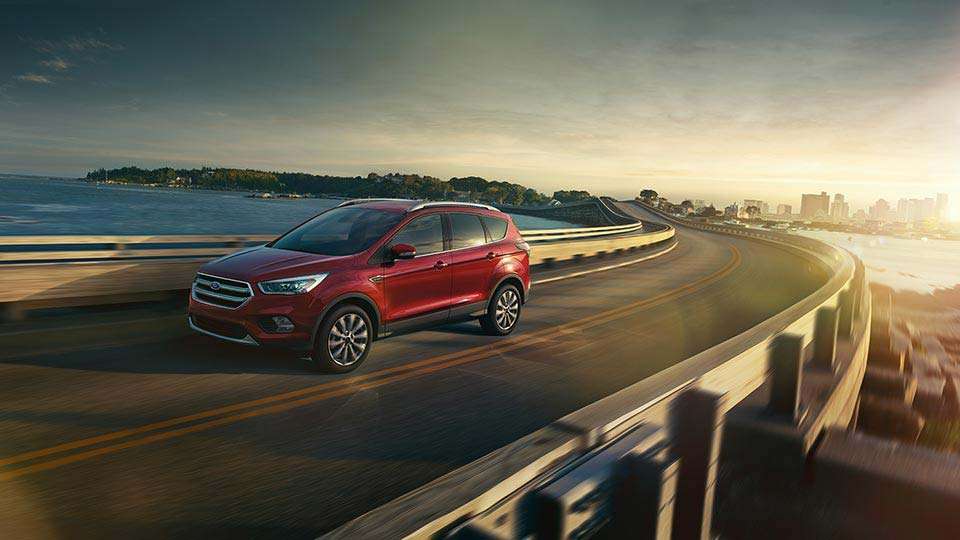 2017 Ford Escape Titanium shown in Ruby Red Metallic