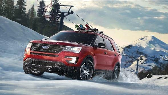 Red Ford Driving through snow